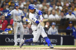 Los Angeles Dodgers' Mookie Betts hits a solo home run during the third inning of a baseball game against the San Diego Padres, Monday, June 21, 2021, in San Diego. (AP Photo/Denis Poroy)