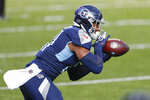 Tennessee Titans tight end Jonnu Smith (81) catches a pass against the Baltimore Ravens in the first half of an NFL wild-card playoff football game Sunday, Jan. 10, 2021, in Nashville, Tenn. (AP Photo/Wade Payne)