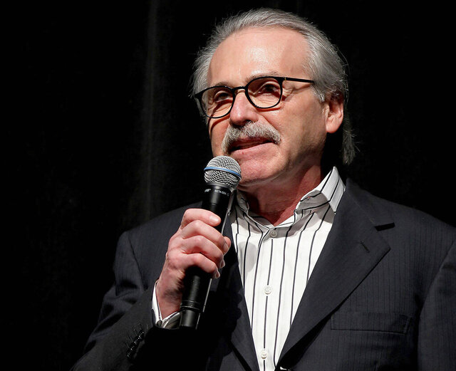 FILE - In this Jan. 31, 2014 photo, David Pecker, chairman and CEO of American Media, addresses those attending the Shape & Men's Fitness Super Bowl Party in New York. In an announcement Friday, Aug. 21, 2020, Pecker is stepping down as CEO of the National Enquirer's parent, ending a reign that saw the company entangled in a campaign-finance scandal that sent President Donald Trump's personal lawyer to jail. Pecker's American Media is being taken over by Accelerate360, a Georgia-based logistics company. (Marion Curtis via AP, File)