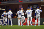 Los Angeles Dodgers players celebrate a 2-1 victory over the San Francisco Giants in a baseball game Friday, May 21, 2021, in San Francisco. (AP Photo/D. Ross Cameron)