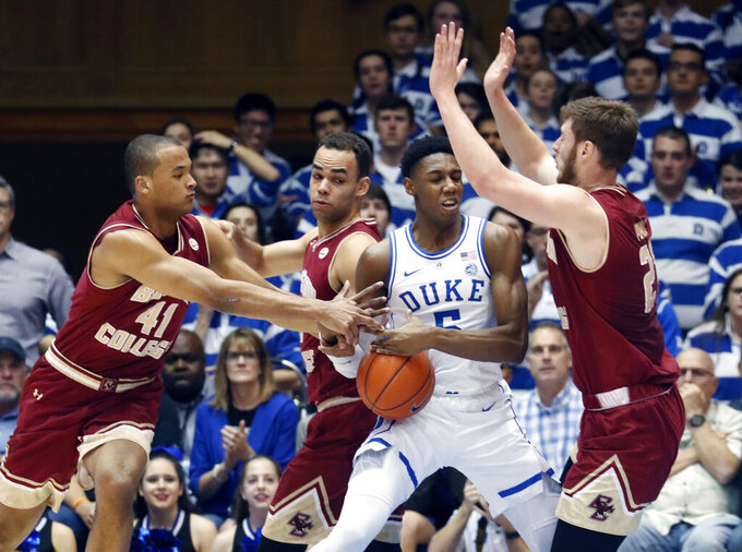 Duke's RJ Barrett (5) is defended by Boston College's Steffon Mitchell (41), Jordan Chatman and Nik Popovic (21) during the first half of an NCAA college basketball game in Durham, N.C., Tuesday, Feb. 5, 2019. (AP Photo/Chris Seward)