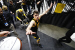Iowa center Luka Garza celebrates with fans after an NCAA college basketball game against Wisconsin, Monday, Jan. 27, 2020, in Iowa City, Iowa. Iowa won 68-62. (AP Photo/Charlie Neibergall)