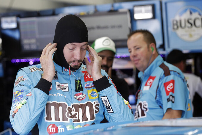 Kyle Busch prepares to practice for Sunday's NASCAR Cup Series auto race at Charlotte Motor Speedway in Concord, N.C., Saturday, Sept. 28, 2019. (AP Photo/Gerry Broome)