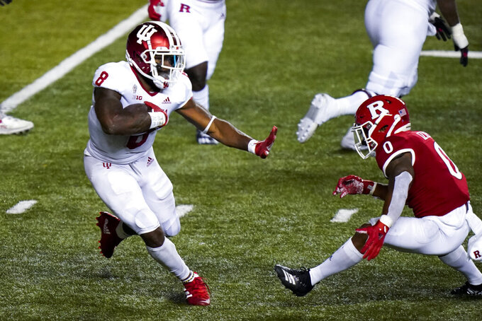 Indiana running back Stevie Scott III (8) gains yardage in the fourth quarter of an NCAA college football game against Rutgers, Saturday, Oct. 31, 2020, in Piscataway, N.J. (AP Photo/Corey Sipkin)