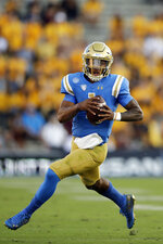 UCLA quarterback Dorian Thompson-Robinson runs against Arizona State during the first half of an NCAA college football game Saturday, Oct. 26, 2019, in Pasadena, Calif. (AP Photo/Marcio Jose Sanchez)