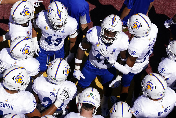 San Jose State players huddle before entering the field before an NCAA college football game against Southern California Saturday, Sept. 4, 2021, in Los Angeles. (AP Photo/Ashley Landis)