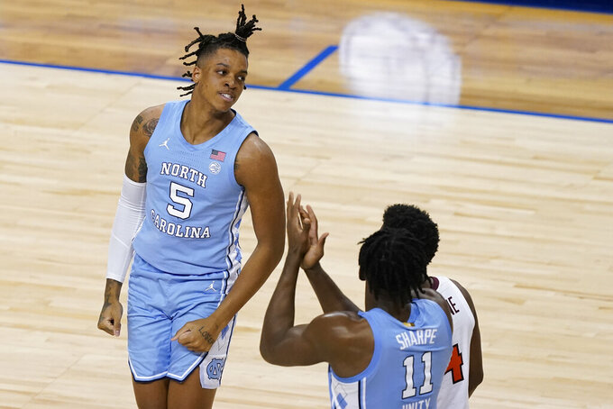 North Carolina forward Armando Bacot (5) reacts to a basket during the second half of an NCAA college basketball game against Virginia Tech in the quarterfinal round of the Atlantic Coast Conference tournament in Greensboro, N.C., Thursday, March 11, 2021. (AP Photo/Gerry Broome)