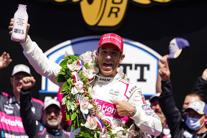 Helio Castroneves of Brazil celebrates after winning the Indianapolis 500 auto race at Indianapolis Motor Speedway in Indianapolis, Sunday, May 30, 2021. (AP Photo/Michael Conroy)
