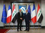 Iraqi Foreign Minister Mohamed Alhakim, right, shakes hands with his visiting French counterpart Jean-Yves Le Drian at the Ministry of Foreign Affairs in Baghdad, Iraq, Thursday, Oct. 17, 2019. (AP Photo/Khalid Mohammed)