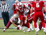North Carolina State's Jakobi Meyers (11) tries to evade a tackle by Florida State's Jaiden Woodbey (20) during the first half of an NCAA college football game in Raleigh, N.C., Saturday, Nov. 3, 2018. (AP Photo/Chris Seward)