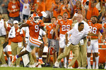 FILE - In this Aug. 29, 2019, file photo, Clemson's Travis Etienne runs down the sideline for a 90-yard touchdown during the first half of an NCAA college football game against Georgia Tech, in Clemson, S.C. Etienne was selected to The Associated Press All-Atlantic Coast Conference football team, and named Offensive Player of the Year, Tuesday, Dec. 10, 2019. (AP Photo/Richard Shiro, File)