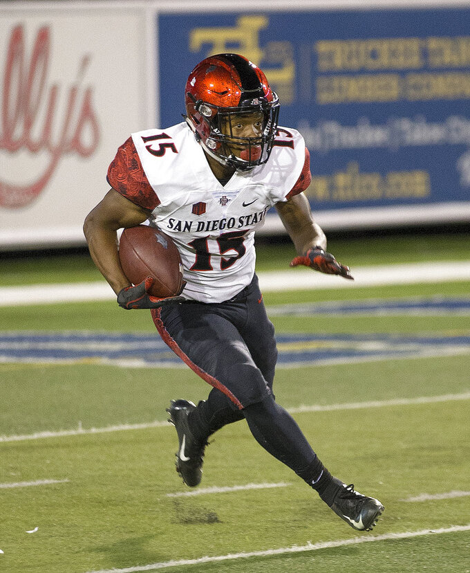 San Diego State's Jordan Byrd (15) runs back a kick against Nevada in the second half of an NCAA college football game in Reno, Nev., Saturday, Oct. 27, 2018. (AP Photo/Tom R. Smedes)