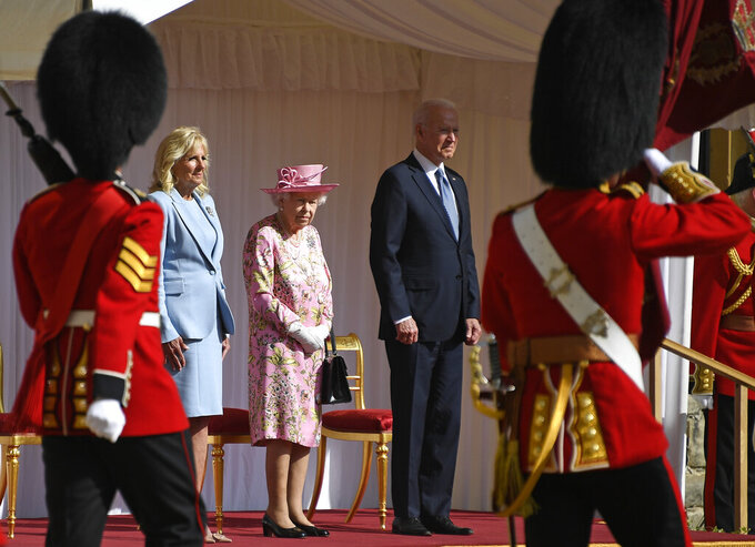 US President Joe Biden takes a salute from a Guard of Honour after arriving with First Lady Jill Biden to meet Britain's Queen Elizabeth II at Windsor Castle near London, Sunday, June 13, 2021. (AP Photo/Alberto Pezzali)