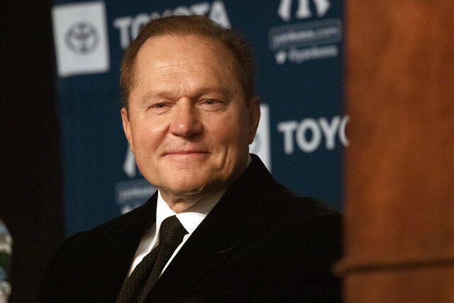 FILE - In this Dec. 18, 2019, file photo, sports agent Scott Boras listens as Gerrit Cole is introduced as the newest New York Yankees player during a baseball media availability in New York. Boras recommends his clients refuse Major League Baseball's attempt to cut salaries during negotiations with the players' association, claiming team financial issues caused by the coronavirus pandemic have their origin in management debt financing. (AP Photo/Mark Lennihan, File)