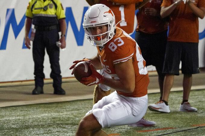 Texas' Kai Money (83) catches a touchdown pass against UTEP during the first half of an NCAA college football game in Austin, Texas, Saturday, Sept. 12, 2020. (AP Photo/Chuck Burton)