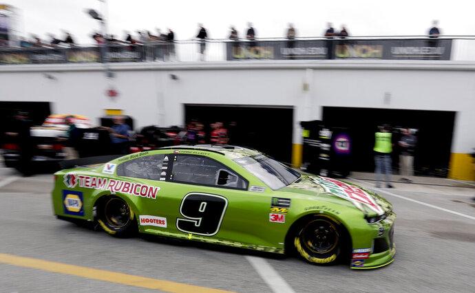 Chase Elliott (9) drives through the garage area during NASCAR auto race practice at Daytona International Speedway, Saturday, Feb. 9, 2019, in Daytona Beach, Fla. (AP Photo/John Raoux)