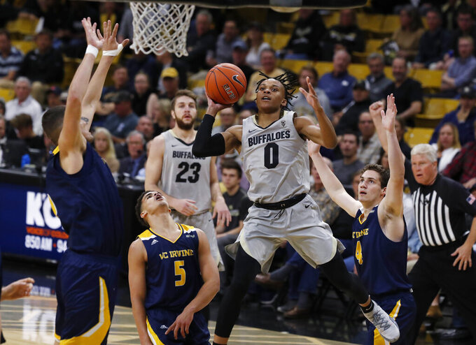 Colorado guard Shane Gatling, third from left, goes up for a basket as, from left, UC Irvine center Brad Greene, guard Isaiah Lee and guard Aiden Krause watch in the second half of an NCAA college basketball game Monday, Nov. 18, 2019, in Boulder, Colo. (AP Photo/David Zalubowski)