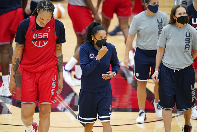 Head coach Dawn Staley, center, coaches during practice for the United States women's basketball team in preparation for the Olympics, Tuesday, July 13, 2021, in Las Vegas. (AP Photo/John Locher)