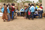 In this photo taken on Tuesday Feb.12, 2019, demobilized child soldiers line up to receive school materials and other supplies during a child soldier release in Yambio, South Sudan. An estimated 19,000 child soldiers are in South Sudan, one of the highest rates in the world, according to the United Nations. As the country emerges from civil war, some worry the fighting could re-ignite if former child soldiers aren't properly reintegrated into society.  (AP Photo/Sam Mednick)