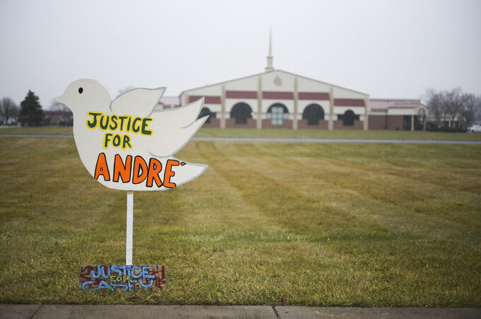 """Signs reading """"Justice for Andre'"""" and """"Justice for Casey,"""" in reference to Andre' Hill and Casey Goodson Jr., both Black men killed at the hands of law enforcement in Columbus, sit outside the First Church of God before the funeral of Andre Hill on Tuesday, Jan. 5, 2021 in Columbus, Ohio.  Hill, a 47-year-old Black man, was shot and killed by Columbus Division of Police Officer Adam Coy in the early morning of Dec. 22, 2020 after officers responded to a non-emergency call in the area.  (Joshua A. Bickel/The Columbus Dispatch via AP)"""