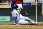 Kansas City Royals' Alex Gordon scores on a sacrifice fly by Meibrys Viloria during the fifth inning of a baseball game against the Minnesota Twins Thursday, Sept. 19, 2019, in Minneapolis. (AP Photo/Jim Mone)