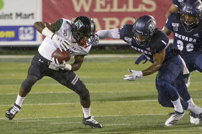 Hawaii receiver JoJo Ward (9) is grabbed by Nevada's Berdale Robins (1) in the first half of an NCAA college football game in Reno, Nev. Saturday, Sept. 28, 2019. (AP Photo/Tom R. Smedes)