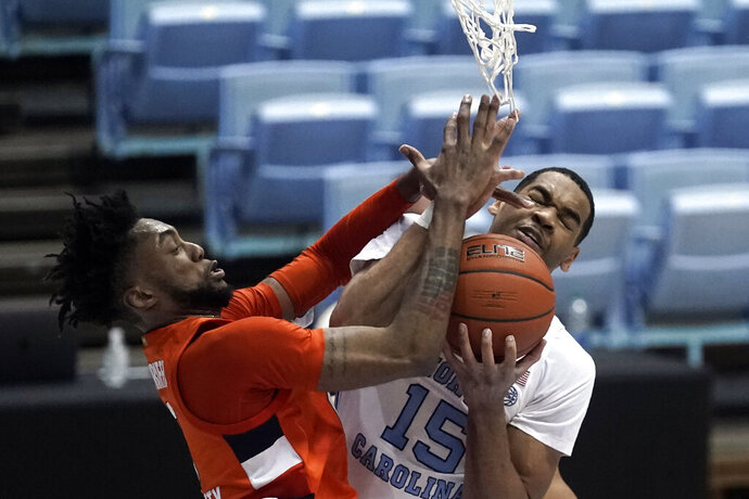 Syracuse forward Alan Griffin and North Carolina forward Garrison Brooks (15) struggle for a rebound during the second half of an NCAA college basketball game in Chapel Hill, N.C., Tuesday, Jan. 12, 2021. (AP Photo/Gerry Broome)