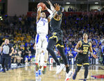 Tulsa guard Elijah Joiner (3) shoots the game winning three pointer over Wichita State forward Trey Wade (5) during an NCAA college basketball game, Saturday, Feb. 1, 2020 in Tulsa, Okla, (Ian Maule/Tulsa World via AP)