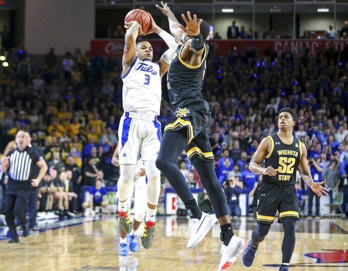 Tulsa guard Elijah Joiner (3) shoots the game winning three pointer over Wichita State forward Trey Wade (5) during an NCAA college basketball game, Saturday, Feb. 1, 2020 in Tulsa, Okla, (Ian Maule/Tulsa World via AP)