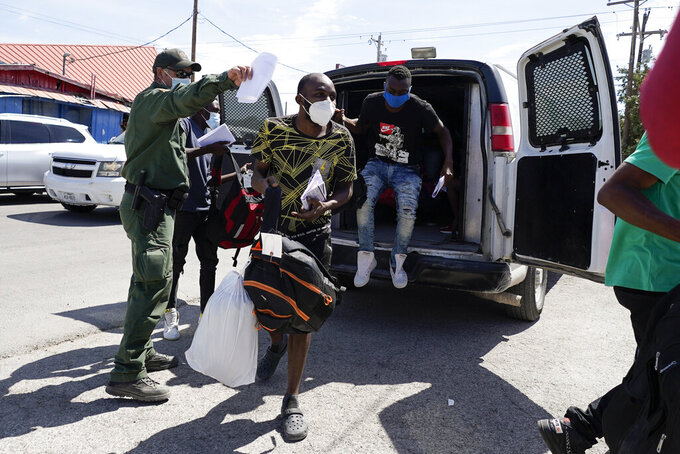 Migrants are released from United States Border Patrol custody at a humanitarian center, Wednesday, Sept. 22, 2021, in Del Rio, Texas. (AP Photo/Julio Cortez)