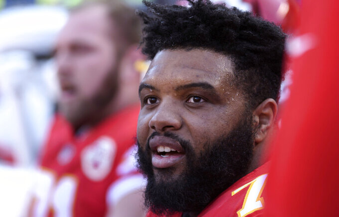 FILE - In this Dec. 9, 2018, file photo, Kansas City Chiefs offensive tackle Jeff Allen is shown during the first half of an NFL football game in Kansas City, Mo. Jeff Allen spent most of the offseason baking cookies with his wife, who began a business back home in Texas. As much fun as he had, though, he was happy to exchange his chef's hat for a football helmet again when the Chiefs called him recently. (AP Photo/Reed Hoffmann, File)