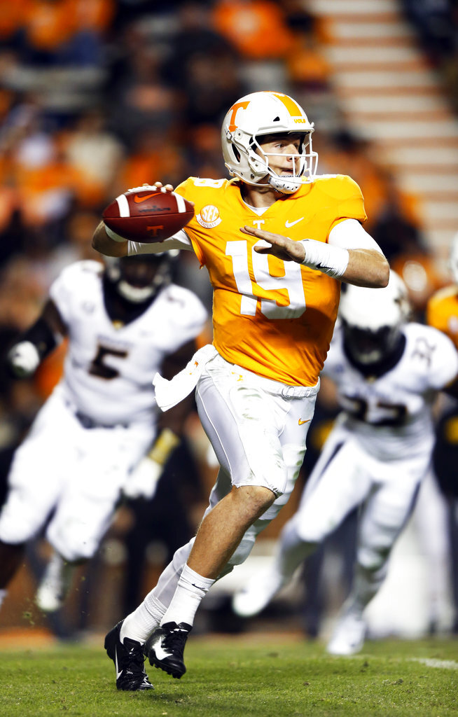 Tennessee quarterback Keller Chryst (19) rolls out to pass in the second half of an NCAA college football game against Missouri Saturday, Nov. 17, 2018, in Knoxville, Tenn. (AP Photo/Wade Payne)