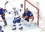 Tampa Bay Lightning's Anthony Cirelli (71) celebrates his overtime goal on New York Islanders goalie Semyon Varlamov (40) in Game 6 of the NHL hockey Eastern Conference final, Thursday, Sept. 17, 2020, in Edmonton, Alberta. (Jason Franson/The Canadian Press via AP)