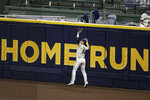 Milwaukee Brewers' Ryan Braun makes a leaping catch at the wall during the sixth inning of a baseball game against the Cincinnati Reds Monday, Aug. 24, 2020, in Milwaukee. (AP Photo/Aaron Gash)