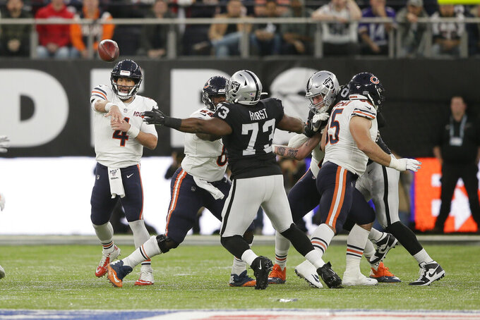 Chicago Bears quarterback Chase Daniel (4) throws during the first half of an NFL football game against the Oakland Raiders at Tottenham Hotspur Stadium, Sunday, Oct. 6, 2019, in London. (AP Photo/Tim Ireland)