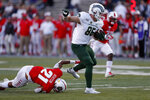 Colorado State tight end Trey McBride (85) breaks a tackle by New Mexico safety Brandon Burton (21) before scoring a touchdown during the first half of an NCAA college football game Friday, Oct. 11, 2019, in Albuquerque, N.M. (AP Photo/Andres Leighton)