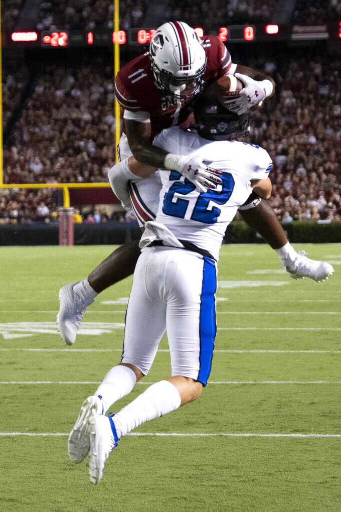 South Carolina running back ZaQuandre White (11) leaps for a touchdown over Eastern Illinoi safety Kaelin Drakeford (22) during the first half of an NCAA college football game on Saturday, Sept. 4, 2021, in Columbia, S.C. (AP Photo/Hakim Wright Sr.)