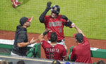 Arizona Diamondbacks' Carson Kelly (18) celebrates with his teammates in the dugout after hitting a pinch-hit home run against the Pittsburgh Pirates during the seventh inning of a baseball game Wednesday, Aug. 25, 2021, in Pittsburgh. (AP Photo/Keith Srakocic)