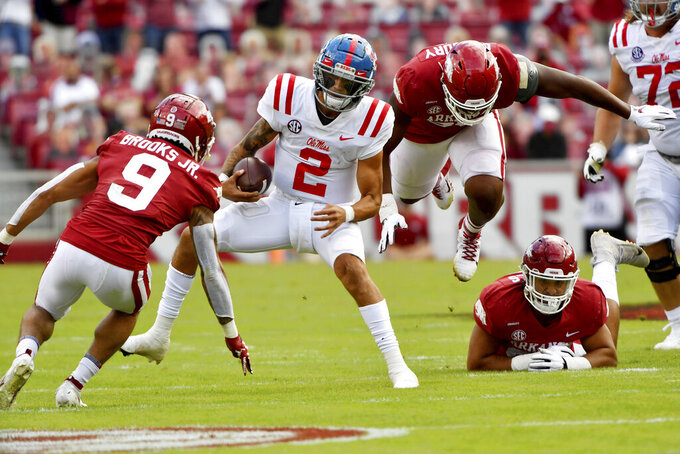 Mississippi quarterback Matt Corral (2) runs the ball against against Arkansas during the first half of an NCAA college football game Saturday, Oct. 17, 2020, in Fayetteville, Ark. (AP Photo/Michael Woods)