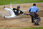 Chicago White Sox's Leury Garcia scores on a wild pitch from Tampa Bay Rays starting pitcher Tyler Glasnow as home plate umpire Ryan Blakney watches during the third inning of a baseball game Monday, June 14, 2021, in Chicago. (AP Photo/Charles Rex Arbogast)