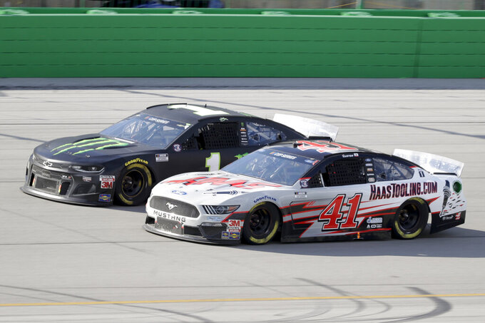 Kurt Busch (1) and Cole Custer (41) work during a NASCAR Cup Series auto race Sunday, July 12, 2020, in Sparta, Ky. (AP Photo/Mark Humphrey)