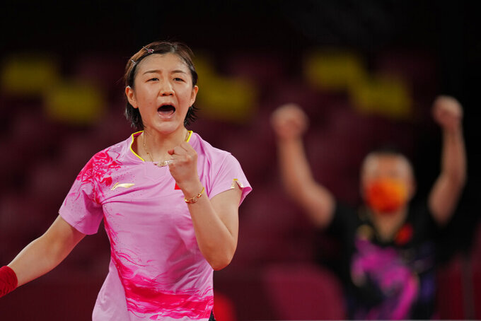 China's Chen Meng celebrates after winning the table tennis women's singles quarterfinal match against Hong Kong's Doo Hoi-kem at the 2020 Summer Olympics, Wednesday, July 28, 2021, in Tokyo. (AP Photo/Kin Cheung)