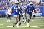Memphis wide receiver Calvin Austin III (4) runs for a touchdown as offensive lineman Dylan Parham (56) follows during the second half of an NCAA college football game against Mississippi State, Saturday, Sept. 18, 2021, in Memphis, Tenn. (AP Photo/John Amis)