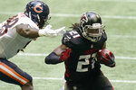 Atlanta Falcons running back Todd Gurley (21) runs against the Chicago Bears during the second half of an NFL football game, Sunday, Sept. 27, 2020, in Atlanta. (AP Photo/Brynn Anderson)
