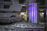 A worker walks through large scale assembly tools in the assembly hall of the ITER ( the International Thermonuclear Experimental Reactor), where components for the ITER Tokamak will be pre-assembled before integration into the machine in Saint-Paul-Lez-Durance, southern France, T Tuesday, July 28, 2020. A project of daunting proportions and giant ambitions replicating the energy of the sun is entering a critical phase as scientists and technicians begin piecing together massive parts built around the globe of a nuclear fusion device, an experiment aimed at showing that clean energy, free of carbon emissions, can keep our planet humming. (AP Photo/Daniel Cole)