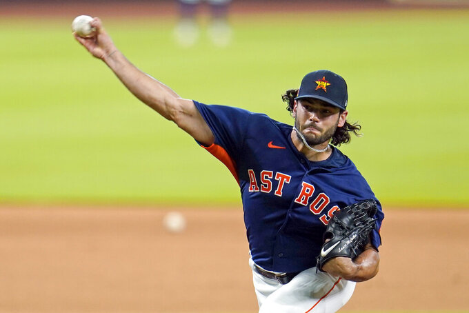 Houston Astros pitcher Lance McCullers Jr. throws during a baseball practice at Minute Maid Park, Saturday, July 4, 2020, in Houston. (AP Photo/David J. Phillip)