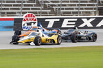 Josef Newgarden, front, Scott Dixon, rear, and Felix Rosenqvist, right, race down the front stretch during an IndyCar auto race at Texas Motor Speedway in Fort Worth, Texas, Saturday, June 6, 2020. (AP Photo/Tony Gutierrez)