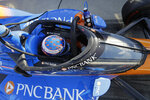 Scott Dixon, of New Zealand, sits in his car during the Aeroscreen testing at Indianapolis Motor Speedway, Wednesday, Oct. 2, 2019, in Indianapolis. (AP Photo/Darron Cummings)