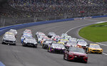 Jimmie Johnson leads the field during a five-wide salute to race fans prior to a NASCAR Cup Series auto race Sunday, March 1, 2020, in Fontana, Calif. (AP Photo/Will Lester)