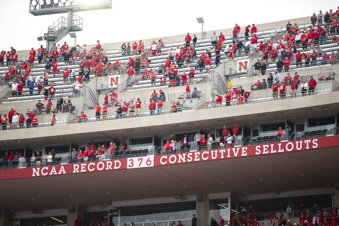 Empty seats remain as fans stand for the national anthem before Nebraska played against Fordham in an NCAA college football game Saturday, Sept. 4, 2021, at Memorial Stadium in Lincoln, Neb. (AP Photo/Rebecca S. Gratz)